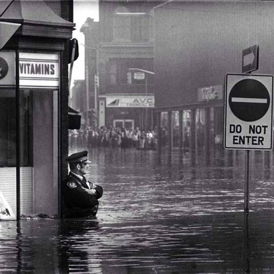 Police-officer-guarding-Galt-Ontario-pharmacy-in-waist-high-flood-waters-May-17-1974