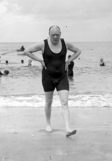 British politician Winston Churchill after bathing in the sea at Deauville, France